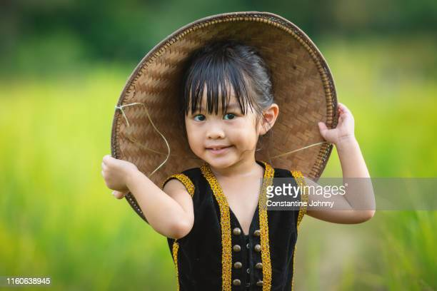 girl in kadazan dusun traditional ethnic costumes in borneo - harvest festival stock pictures, royalty-free photos & images