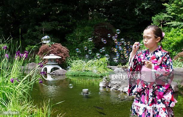 girl in kimono with soap bubbles