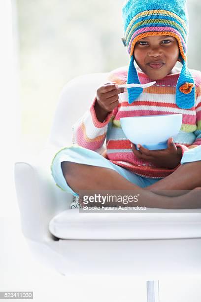 Girl in Knit Cap Eating
