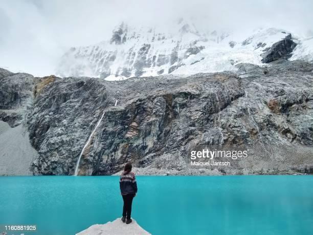 girl in laguna 69 (lake 69) in peru. - national landmark stock pictures, royalty-free photos & images