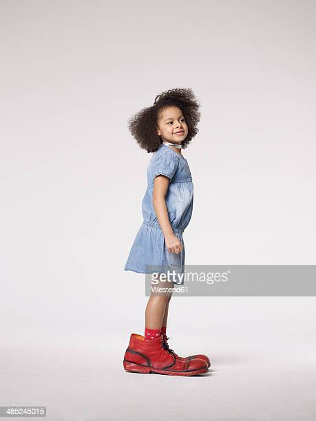 Girl in large clown shoes