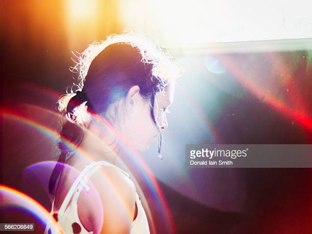Girl in light with sun flare