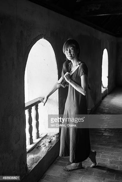 girl in long dress by window - robe longue photos et images de collection