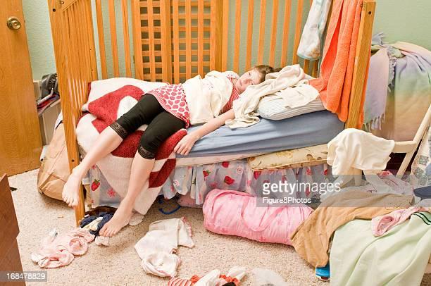 Girl in messy bedroom