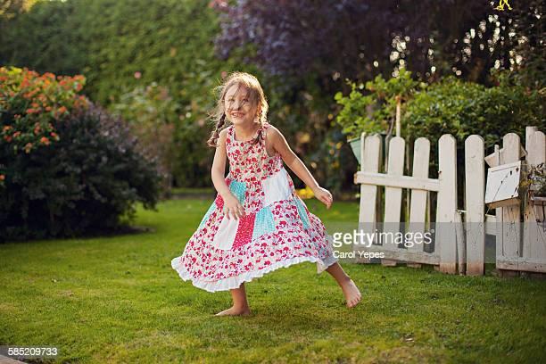 Girl in motion in garden