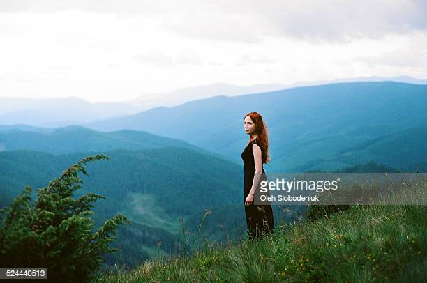 girl in mountains - black dress stock pictures, royalty-free photos & images