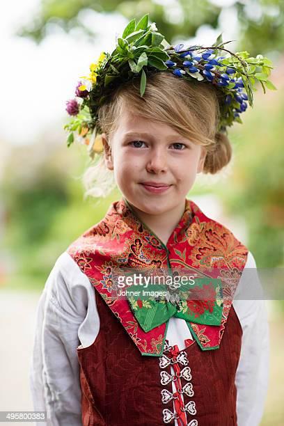 Girl in national costume wearing flower wreath, Sandham, Sweden