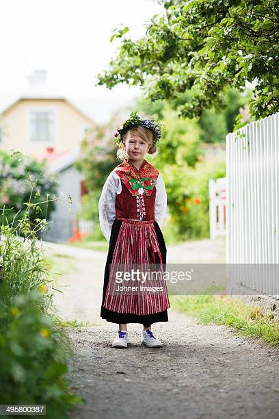 Girl in national costume wearing flower wreath, Sandham, Sweden