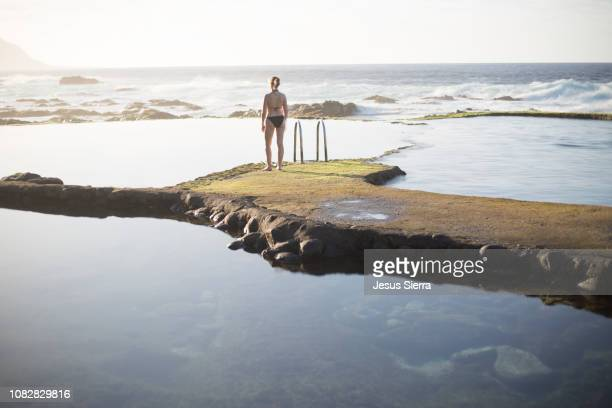 girl in natural swimming pool, el hierro - atlantic islands stock pictures, royalty-free photos & images