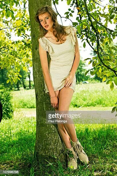 girl in orchard - minikleid stock-fotos und bilder