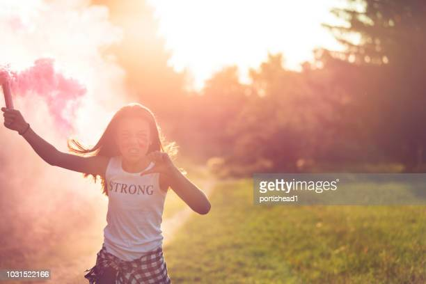 Girl in pink smoke