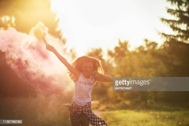 girl in pink smoke - revolution stock pictures, royalty-free photos & images