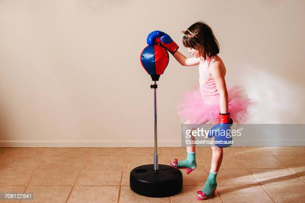girl in pink tutu and high heel shoes learning to box - funny boxing stock photos and pictures