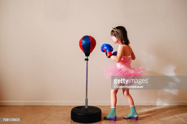 girl in pink tutu and high heel shoes learning to box - gegensatz stock-fotos und bilder