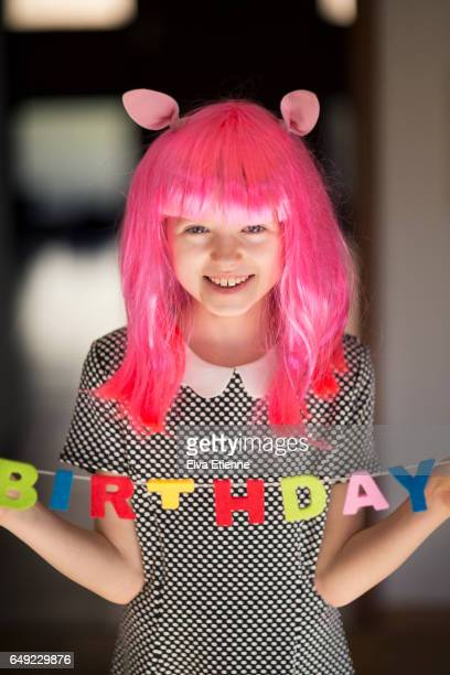Girl in pink wig, with Birthday decoration