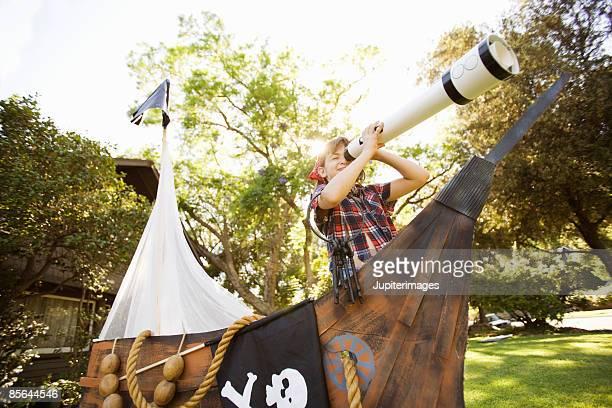 Girl in pirate holding telescope