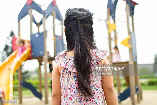 girl in playground - nga nguyen stock pictures, royalty-free photos & images