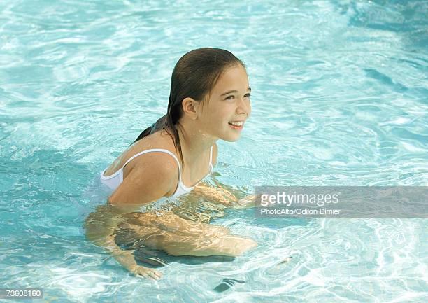 Girl in pool, smiling