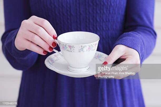 Girl in Purple Dress Holding Teacup