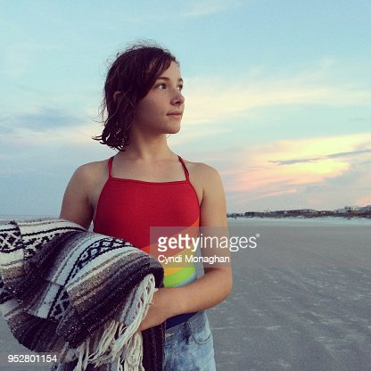 Girl in Rainbow Swimsuit at Sunset