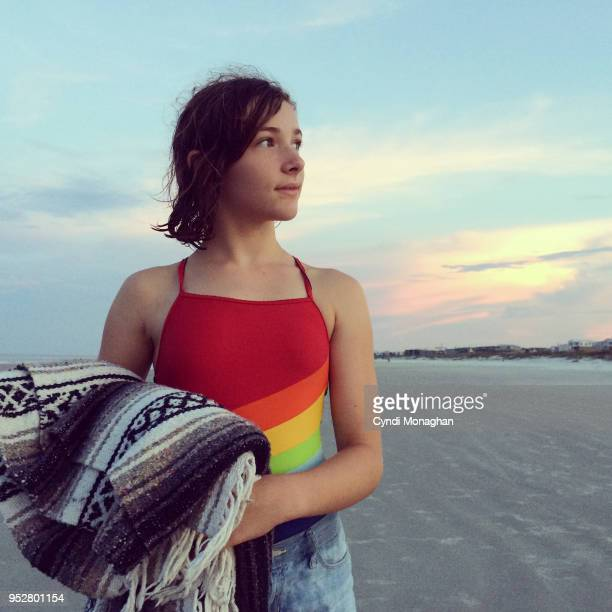 Girl in Rainbow Swimsuit at Sunset