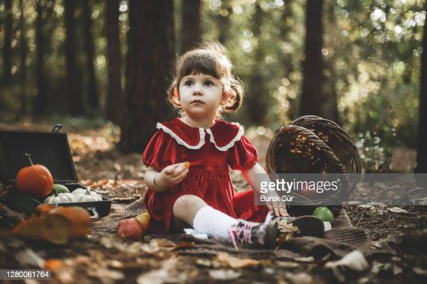 girl in red dress and halloween celebration concept, pumpkin - red dress stock pictures, royalty-free photos & images