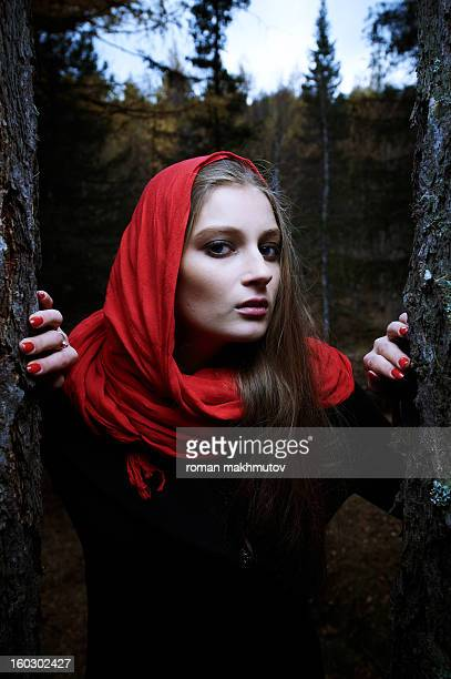 Girl in red shawl in the woods