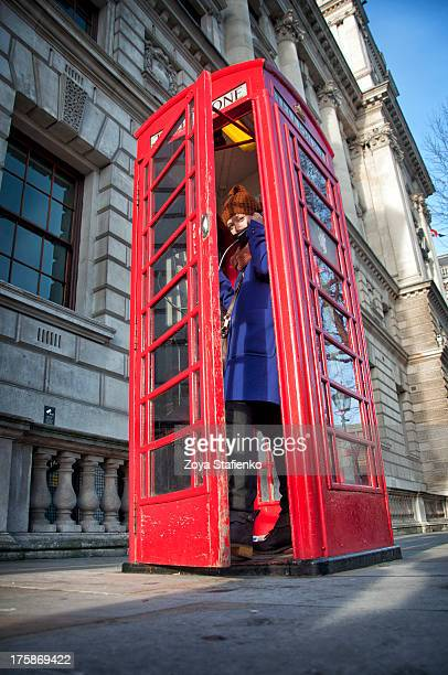 girl in red telephone box in london - telephone box stock pictures, royalty-free photos & images