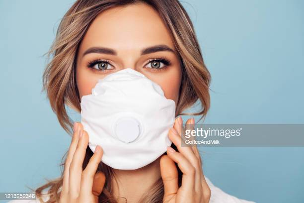 girl in respiratory mask - beautiful woman stock pictures, royalty-free photos & images