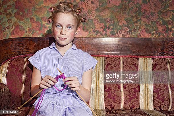 Girl in rollers knitting
