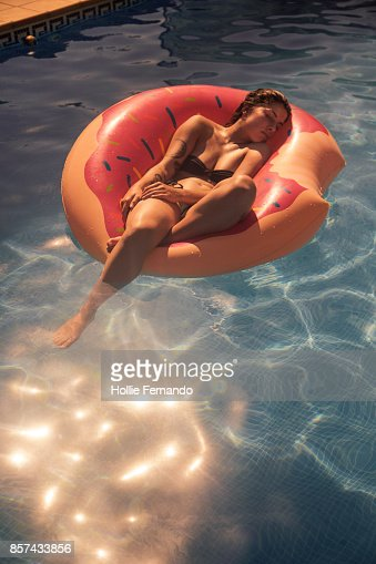 Girl in Rubber Ring in Swimming Pool