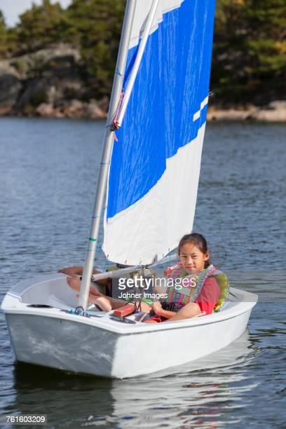 Girl in sailing boat.