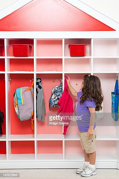 girl in school cloakroom - coat stock pictures, royalty-free photos & images