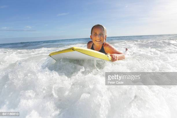 Girl in sea with bodyboard