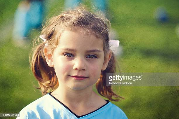 girl in soccer uniform - rebecca nelson stock pictures, royalty-free photos & images