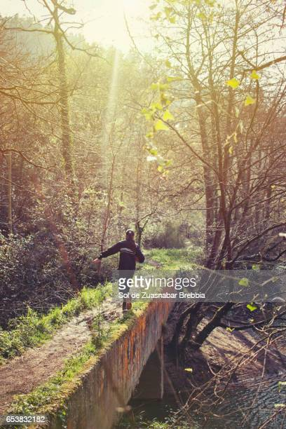 Girl in sportswear running around in nature on a beautiful sunny day