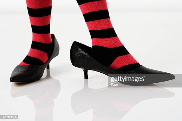 girl in striped stockings wearing adult shoes - nylon feet stock photos and pictures