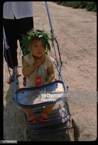 Girl in Stroller at Xian