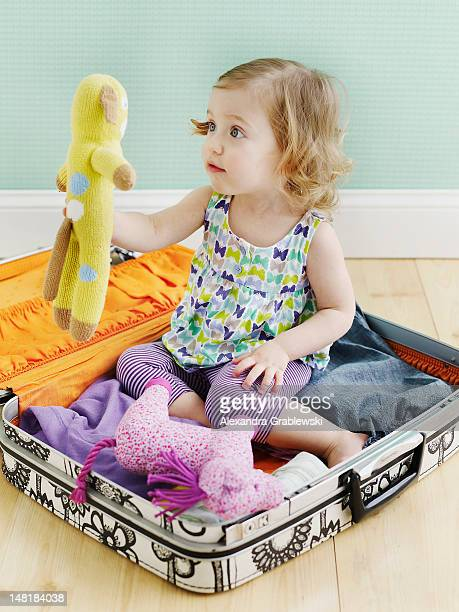 Girl in Suitcase with Toy