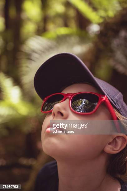 Girl in sunglasses looking up