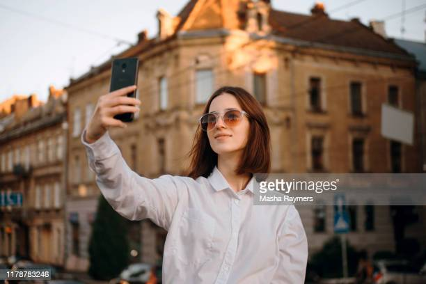 girl in sunglasses making selfie - selfie stock pictures, royalty-free photos & images