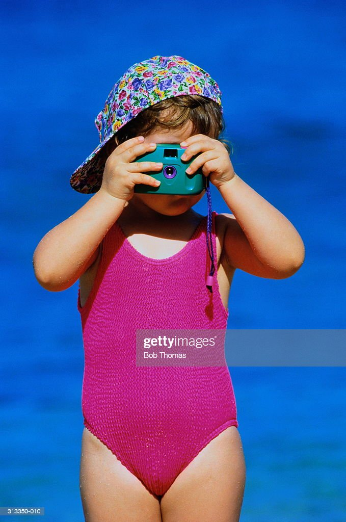 Girl In Swimming Costume And Floral Cap Taking Photosea Behind Photo