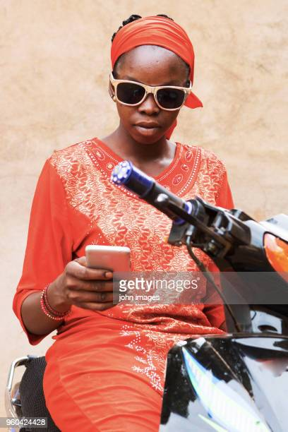 a girl in telephone communication - mali photos et images de collection