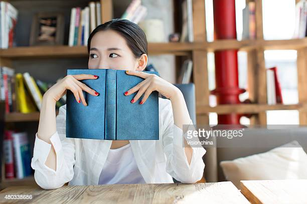 girl in the  bookstore  reading
