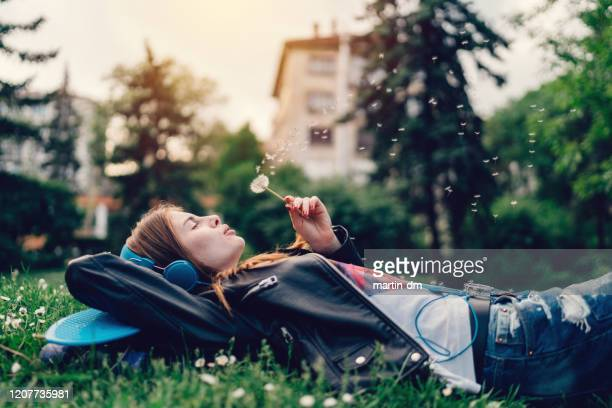 girl in the city - lying down stock pictures, royalty-free photos & images