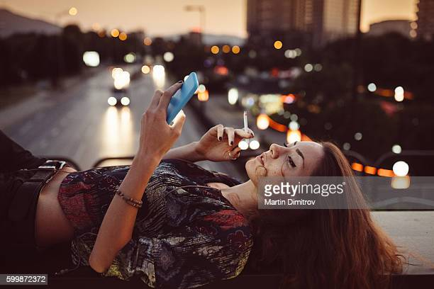 girl in the city - little girl smoking cigarette stock photos and pictures