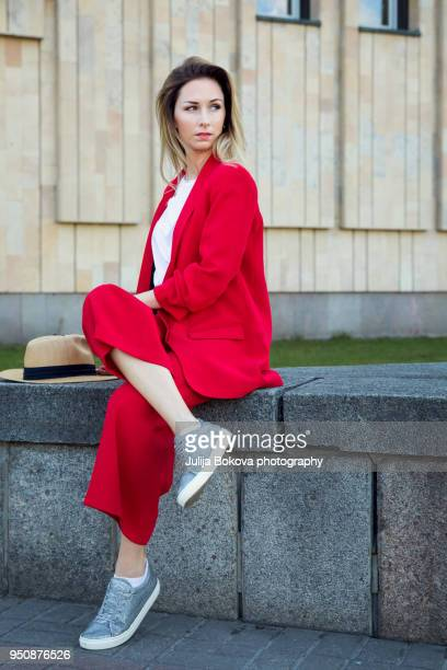 girl in the city - red suit stock pictures, royalty-free photos & images