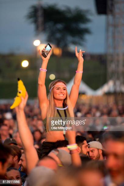 A girl in the crowd on her friends shoulders watches on as Fetty Wap performs onstage during Day 7 of the 50th Festival D'ete De Quebec on the Main...