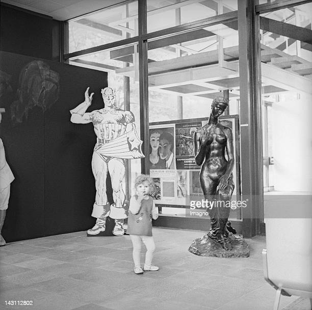A girl in the exhibition 'Comic Strip' Museum des 20 Jahrhunderts Vienna Photograph 1970