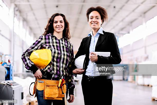 Girl in the factory with her female boss